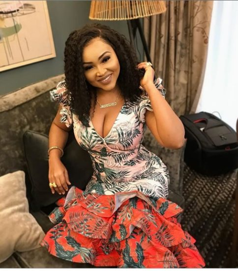 Mercy Aigbe Shares Beautiful Images of Herself Rocking A Plunging Gown